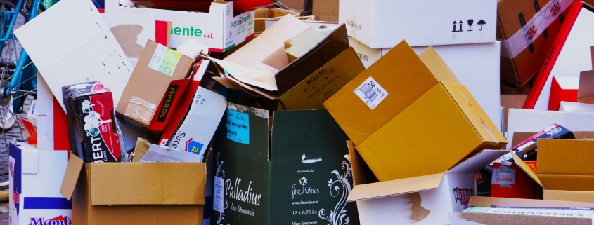 A messy pile of boxes of all sizes